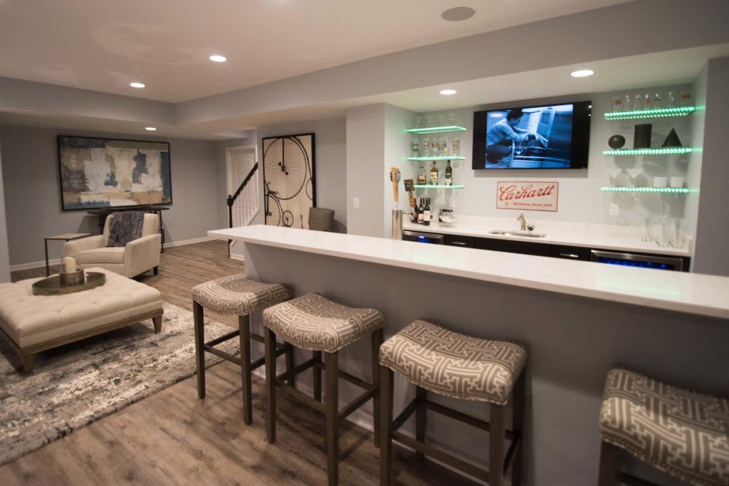 basement modern bar in Novi, MI with led glass shelving and brown rustic vinyl plank flooring
