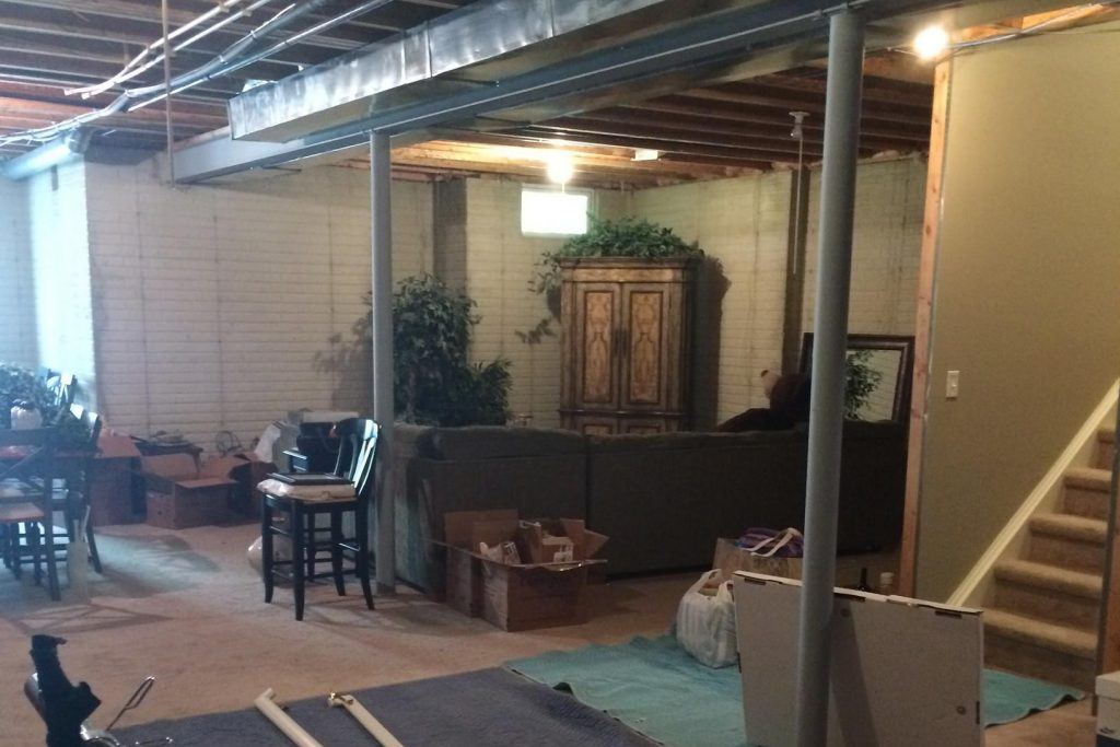unfinished basement with no flooring or ceiling