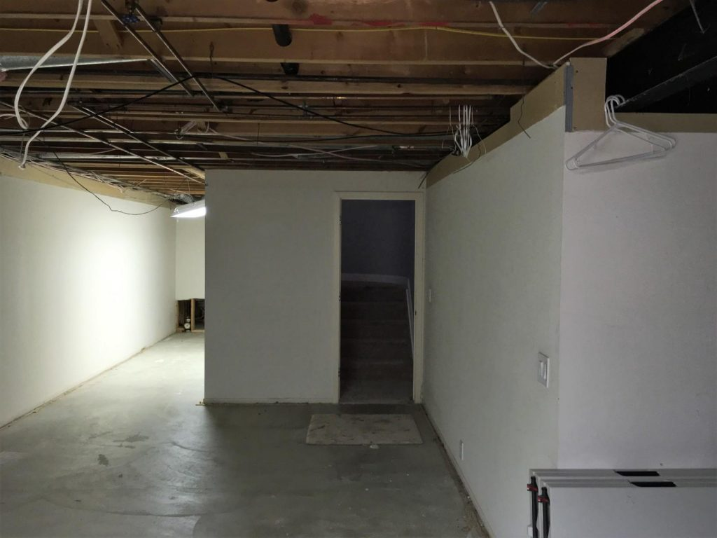 basement finishing project with closed off bad layout