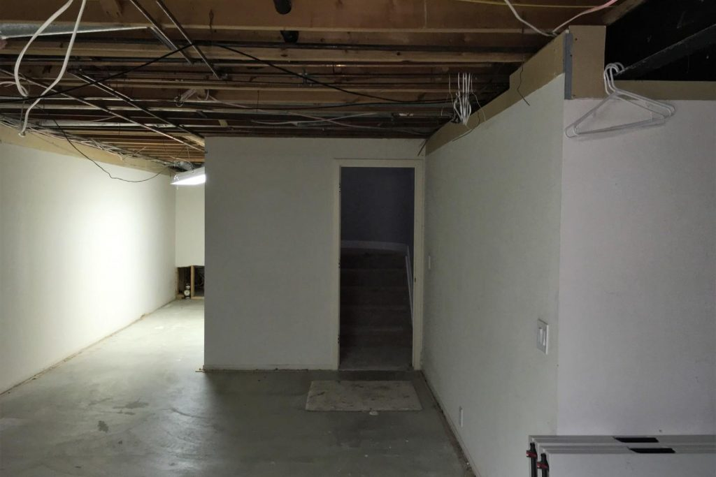 basement with closed off bad layout