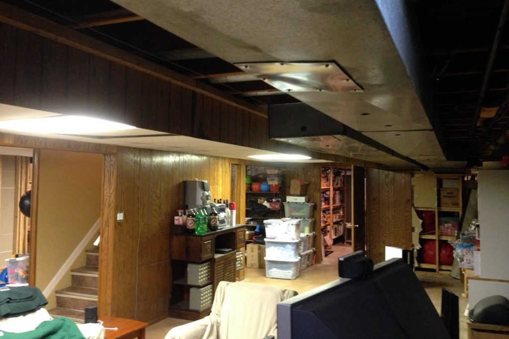 low dark ceiling basement with old paneling