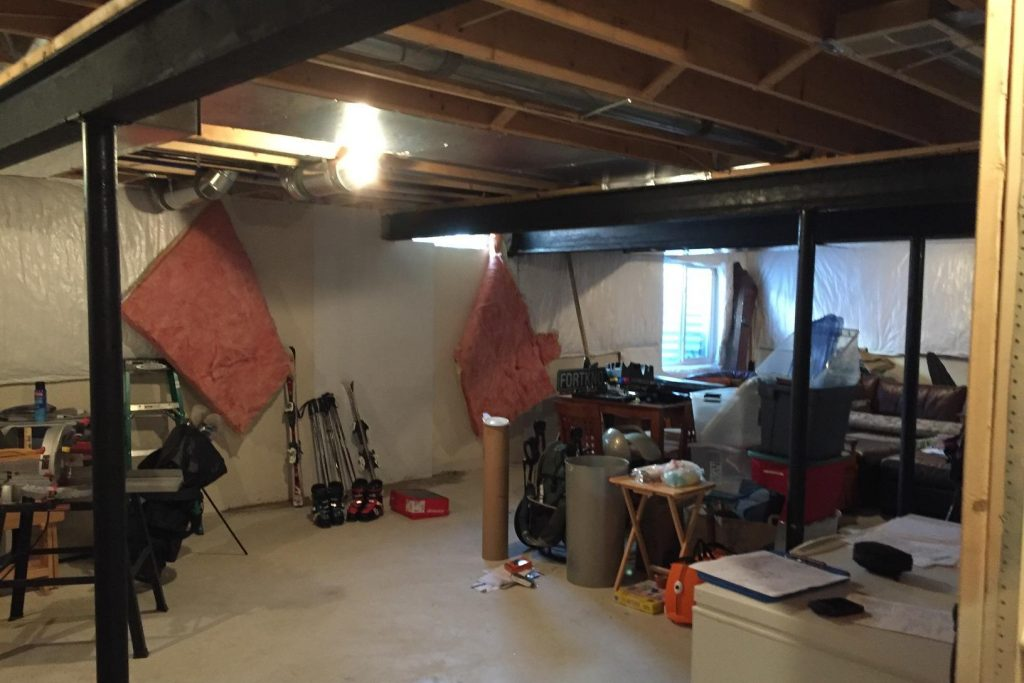 unfinished basement with insulation on the walls