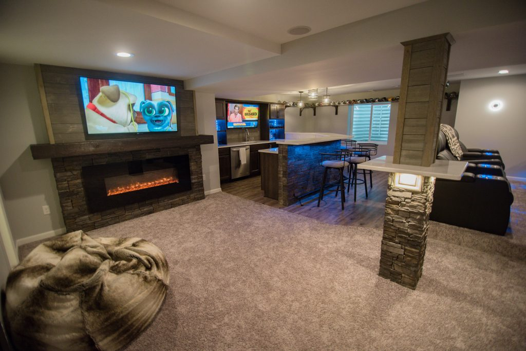 finished basement with carpet and vinyl plank flooring