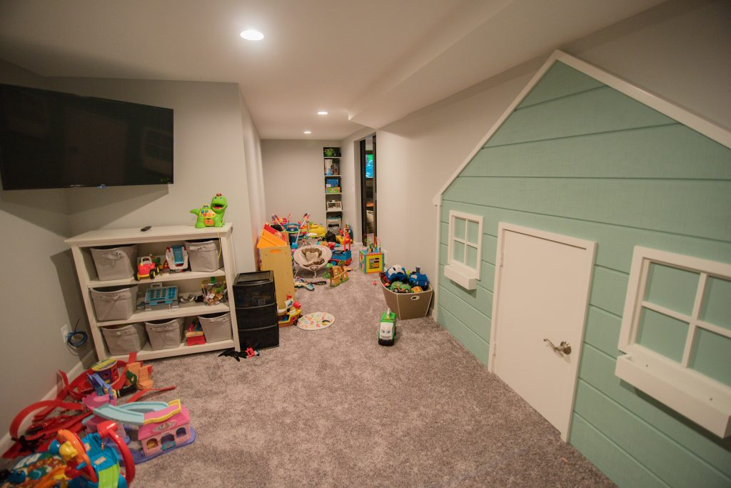 finished basement playroom for kids with built in doll house