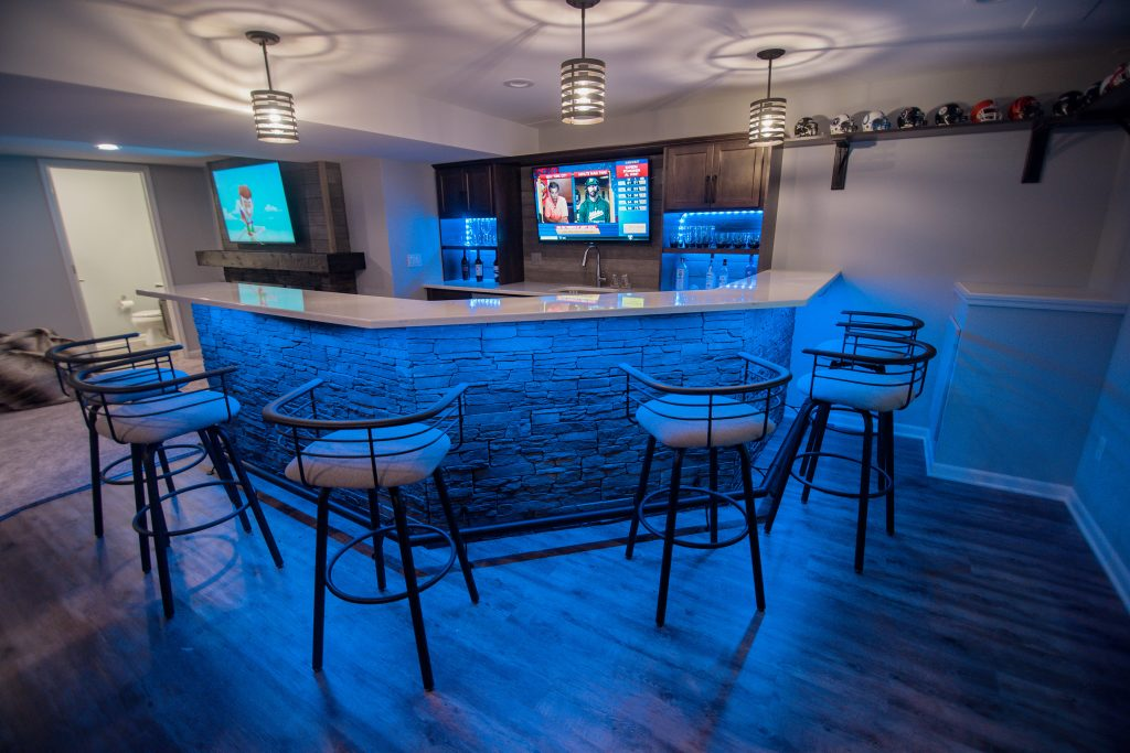 bright led bar with led lighting and stools with stone backing