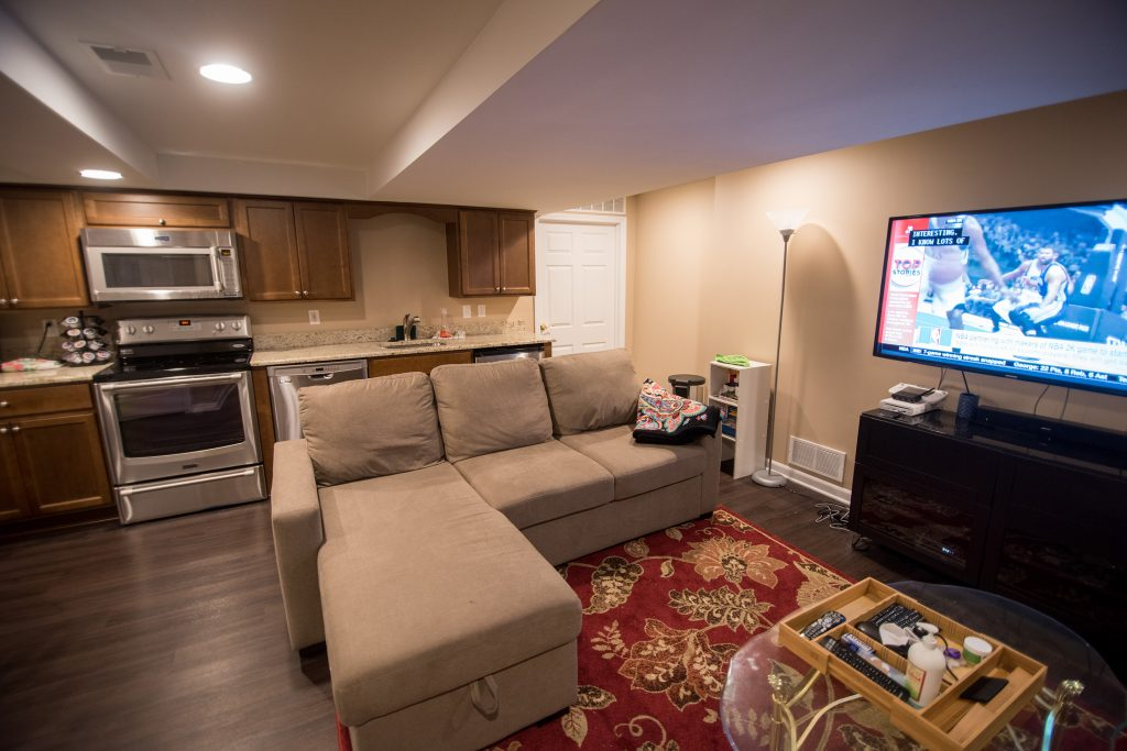 Finished basement in Troy, MI re purposed into space for kitchen and living room