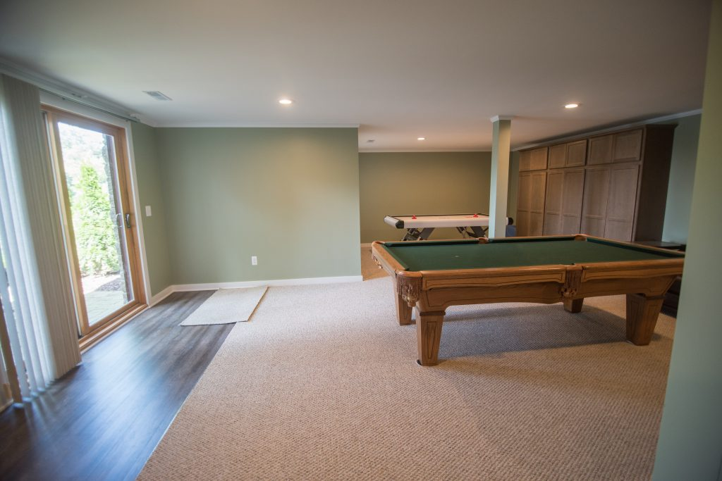 basement walkout with carpet and pool table