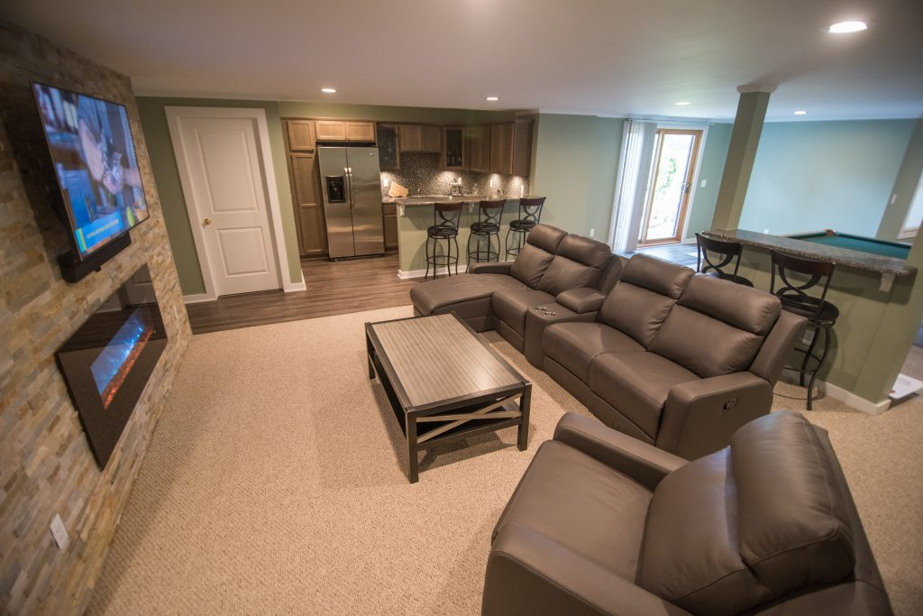 walkout basement with comfortable carpet and vinyl plank flooring