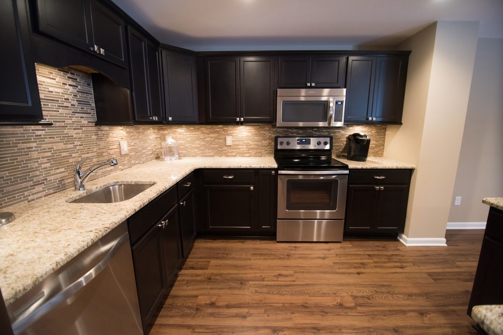 novi michigan finished basement with vinyl plank and kitchen with granite