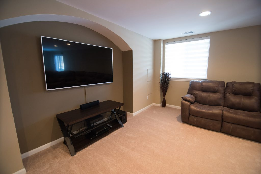 archway in wall of basement for TV