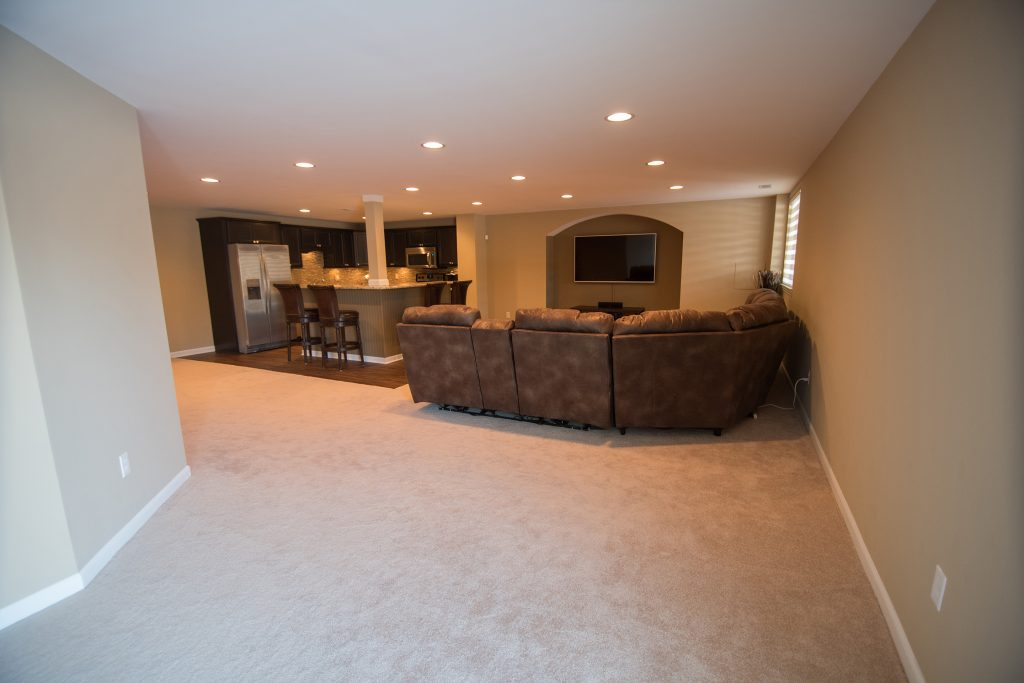 finished basement with living room and bar area