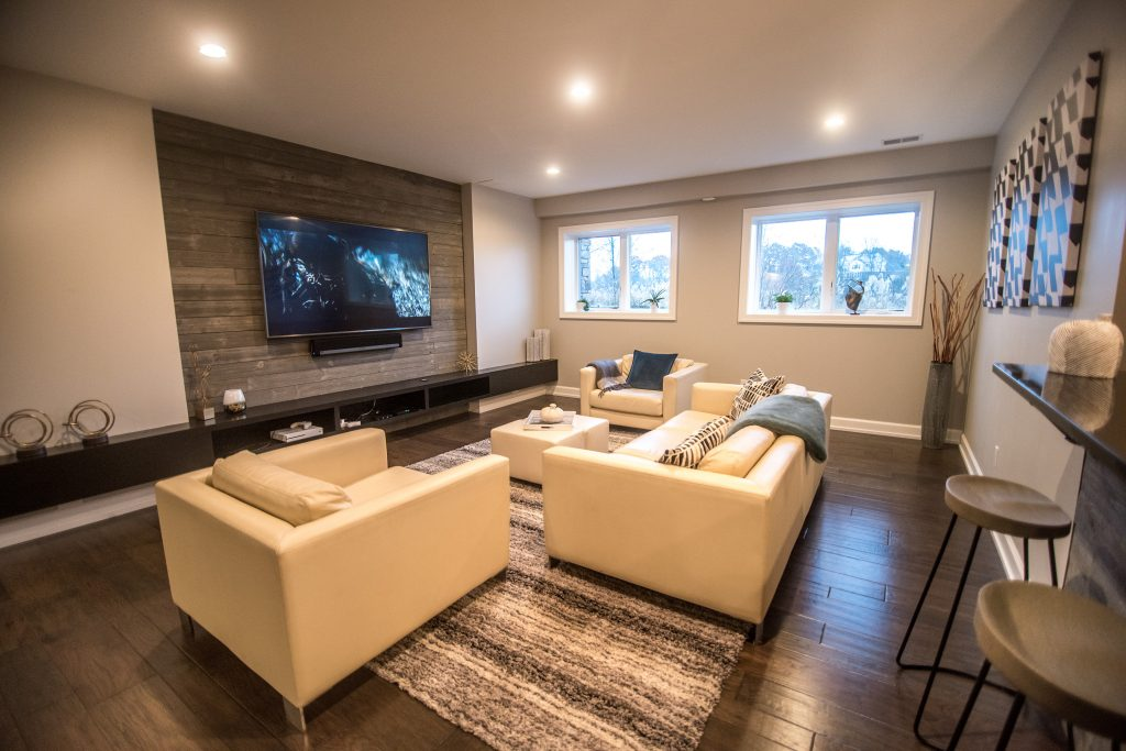 Basement living room with large windows