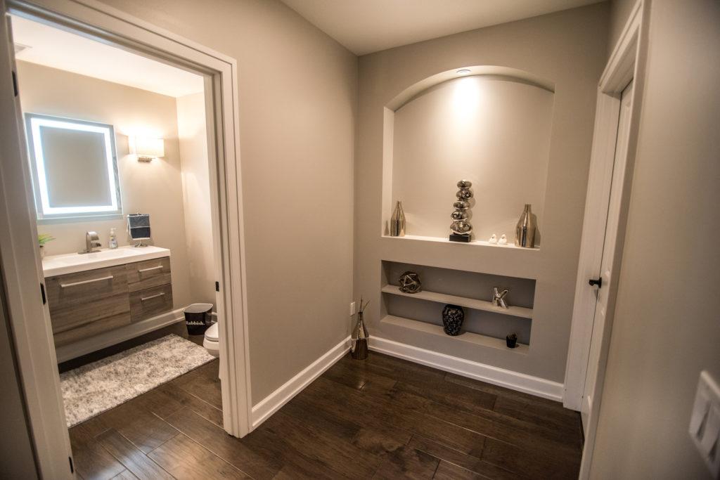 shelving niche in hallway to basement bathroom