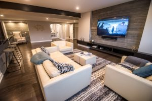 seating area in modern industrial basement design in Commerce, MI