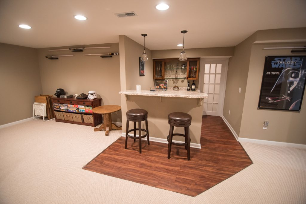 finished basement with bar area with vinyl plank flooring