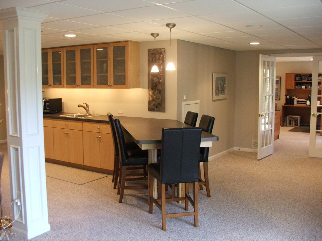 remodeled basement with bar area and usable space