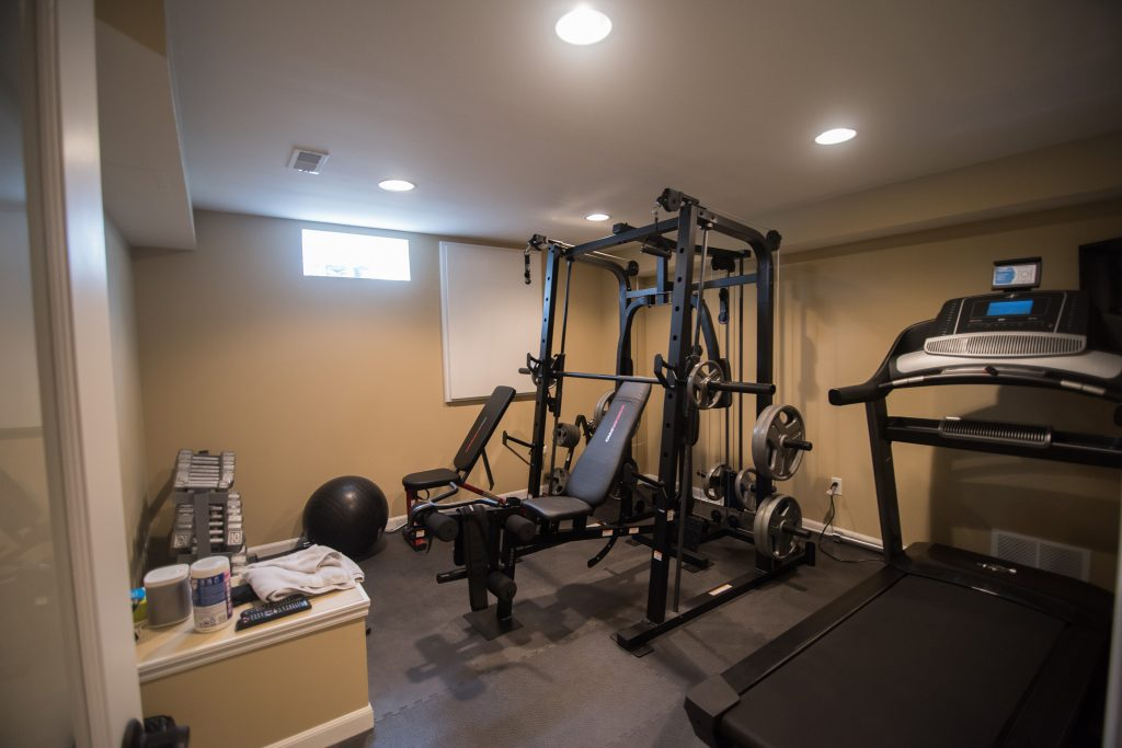 basement fitness room with rubber flooring