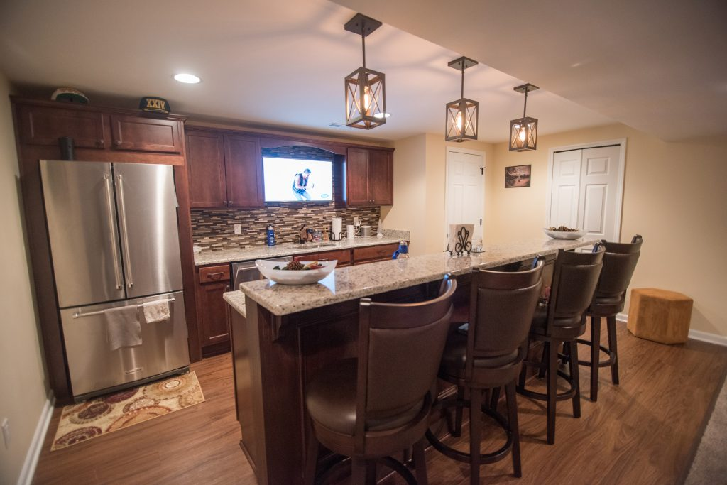 traditional basement design with carpet tori maple cabinets and granite countertops