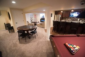 basement with pool table and poker table carpet