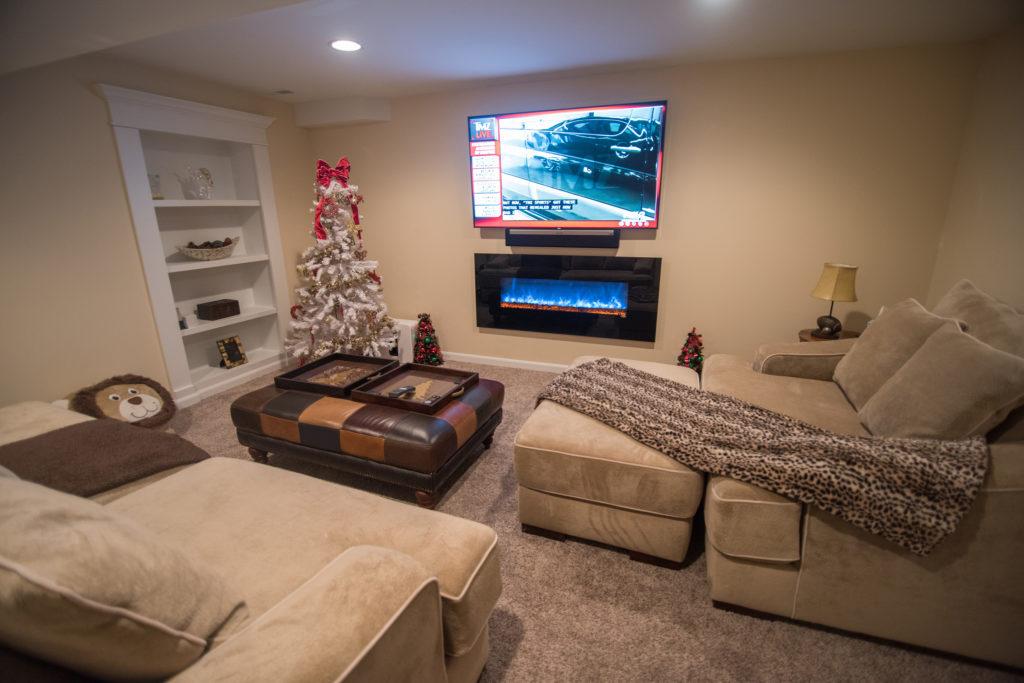 baseent living room with secret bookcase door
