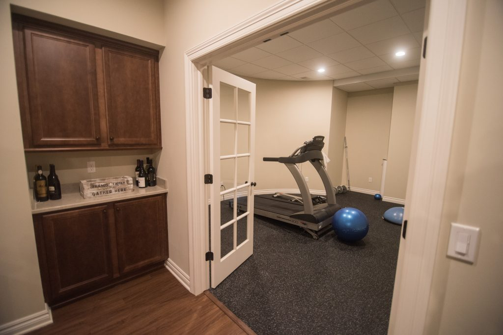 basement exercise area with french doors