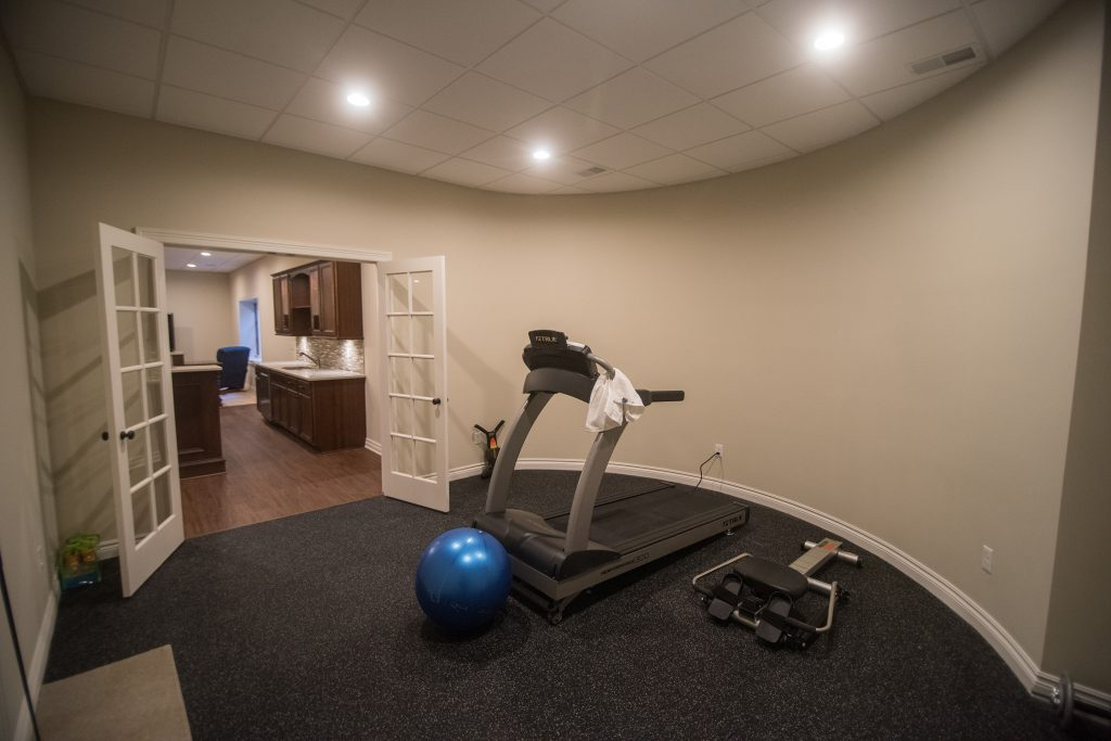 basement exercise room with french doors