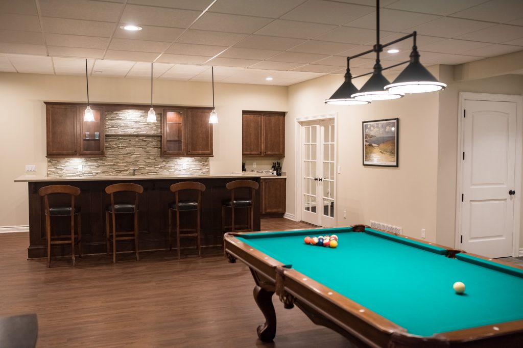 pool table in basement with classic finishes