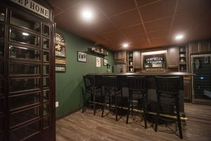 phone booth in finished basement with a pub style bar design
