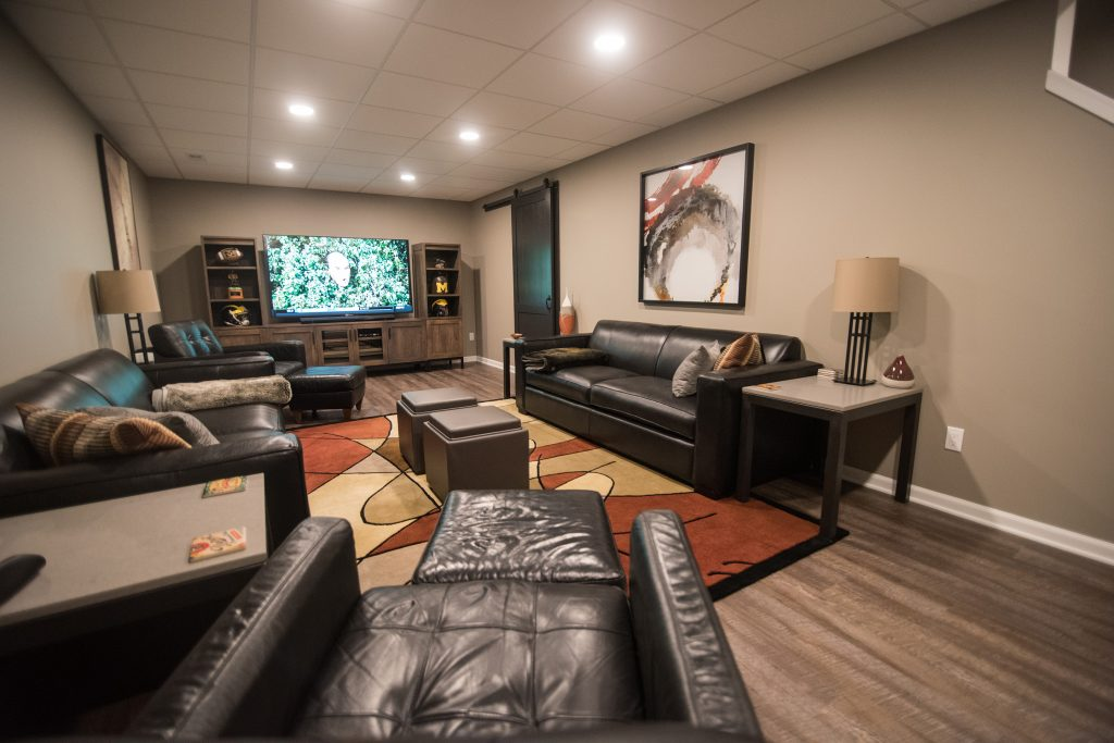 plenty of seating in finished basement with vinyl plank flooring