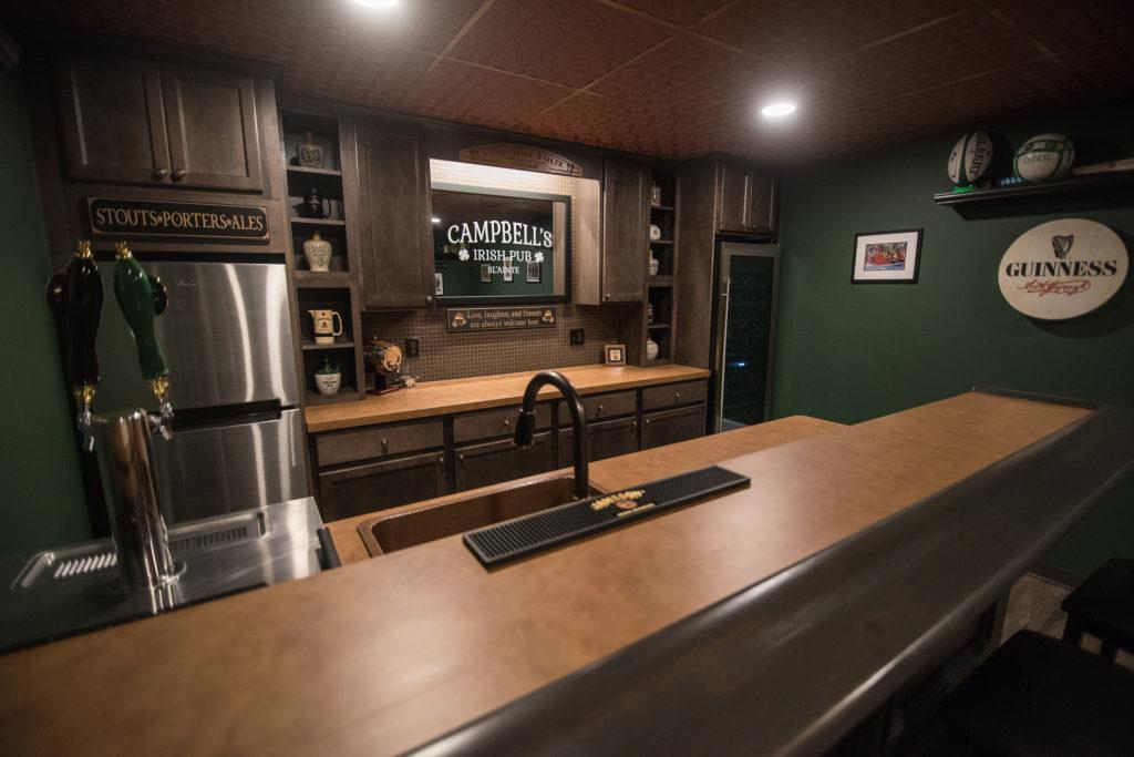 custom finished basement bar with Irish bar