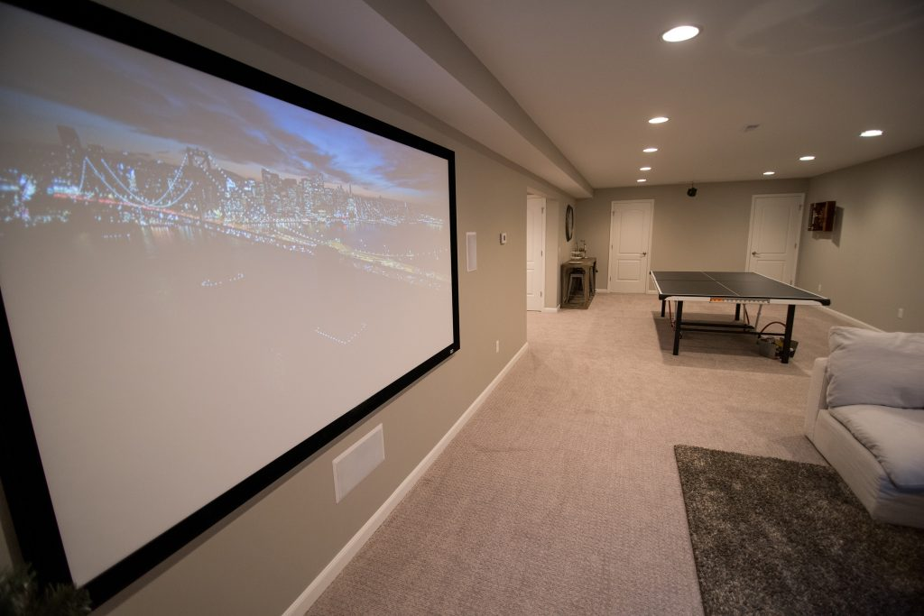 projection tv in finished basement for movies
