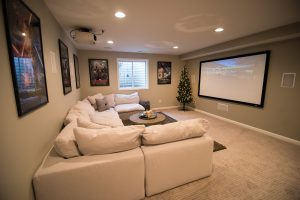 bright light grey basement with carpet and large sectional in Brighton, MI