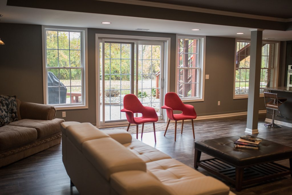 walkout basement with sectional seating area for entertaining