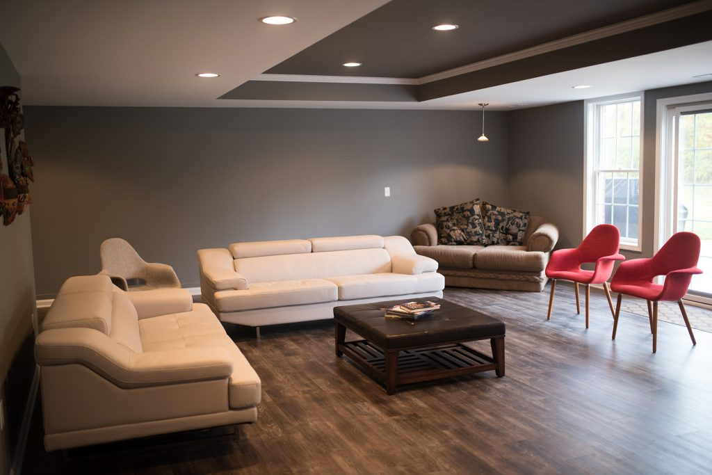 finished basement living room with seating