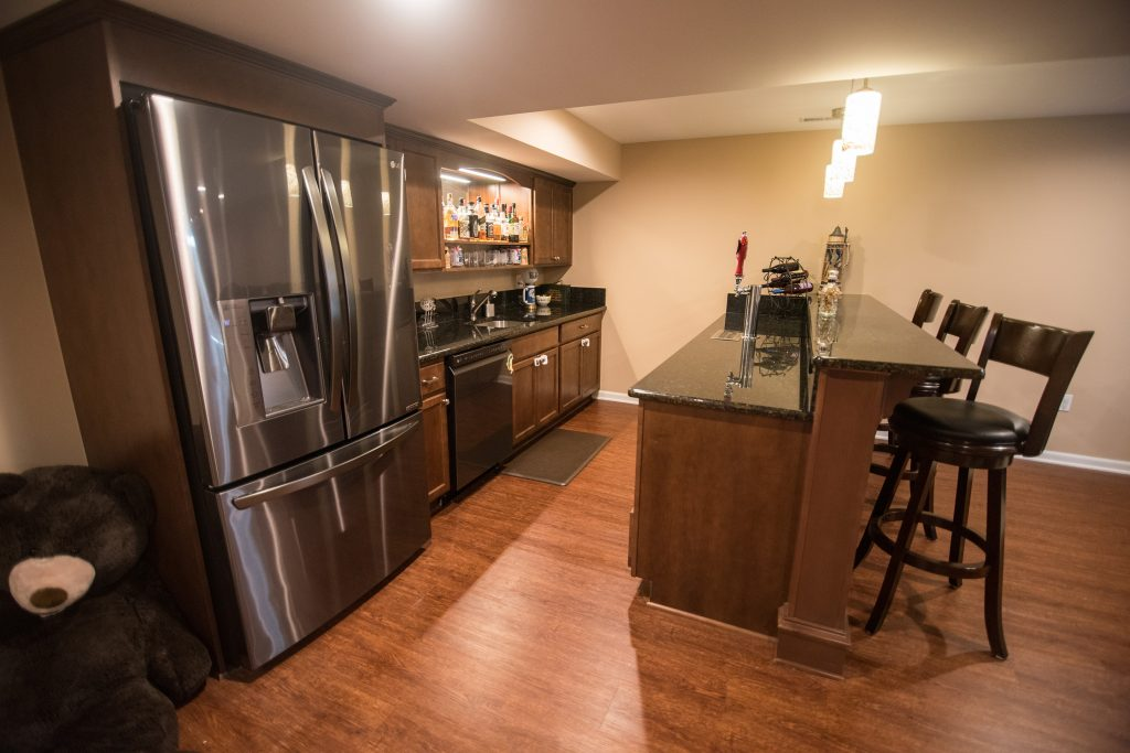 basement kitchen with vinyl plank flooring and granite countertops