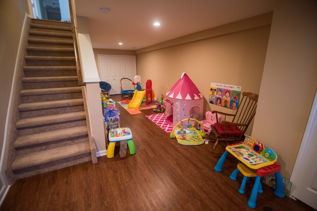 basement playroom for the kids with vinyl plank flooring