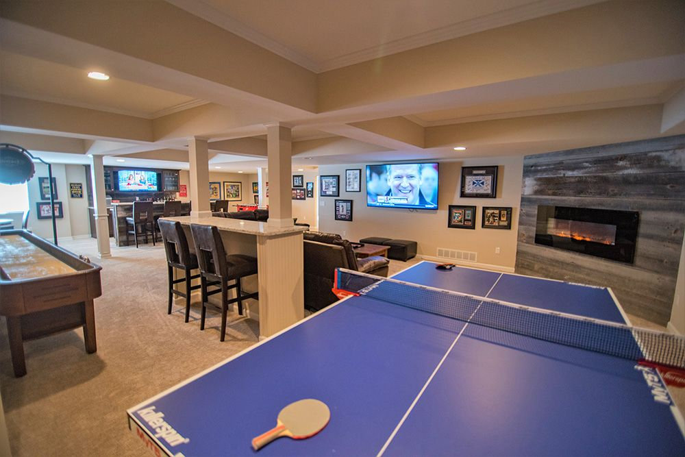 open concept basement with detailed ceiling and carpeting