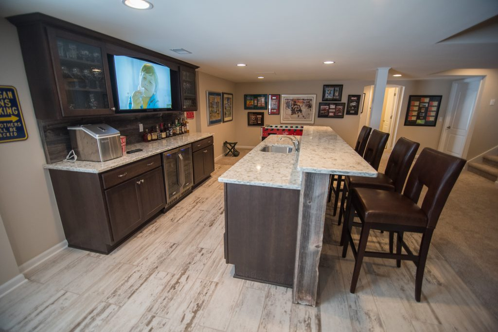basement bar with vinyl tile and rustic reclaimed wood bar