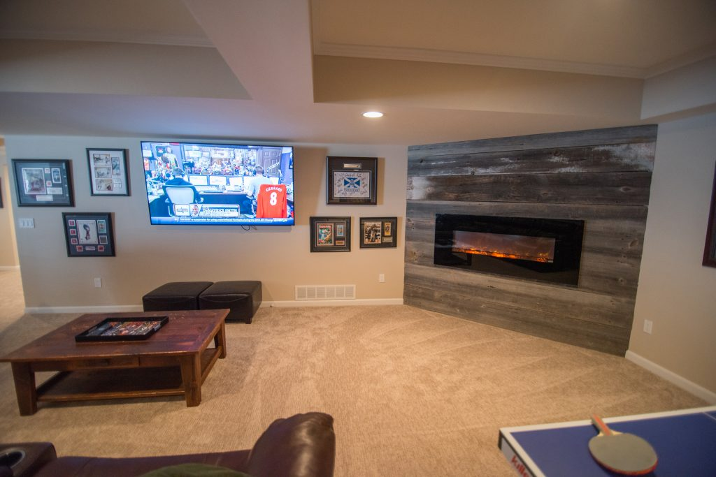 reclaimed wood planks on electric fireplace surround