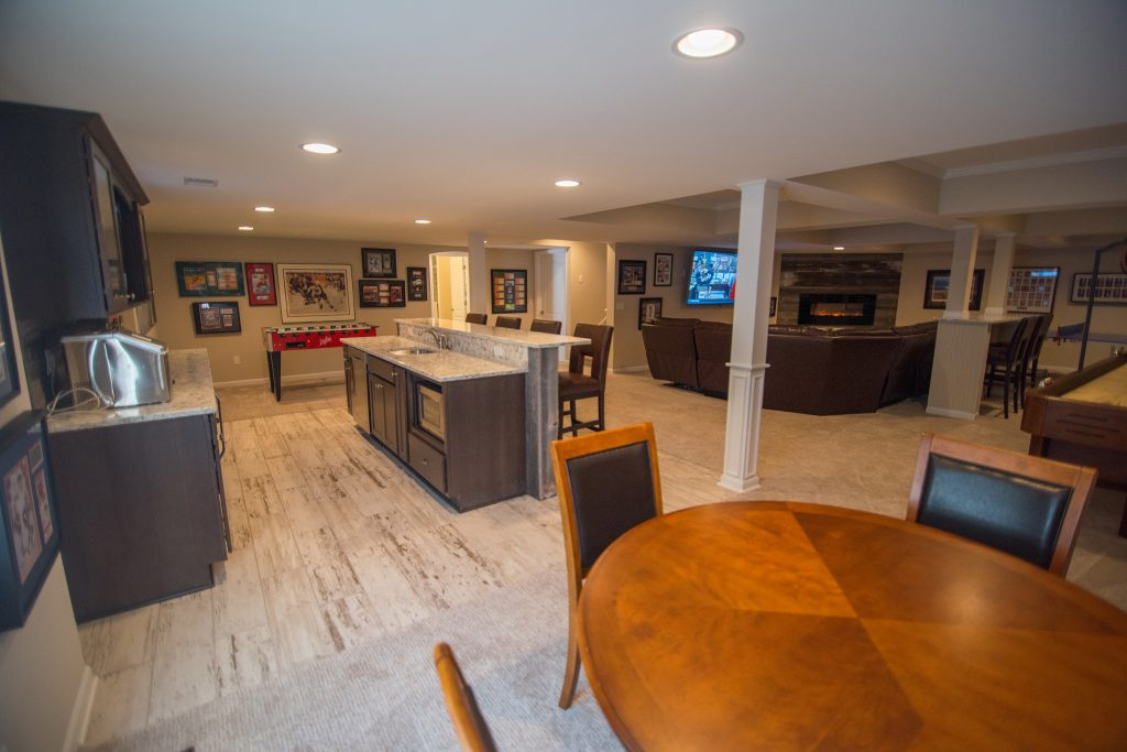 finished basement with post wraps and bar area