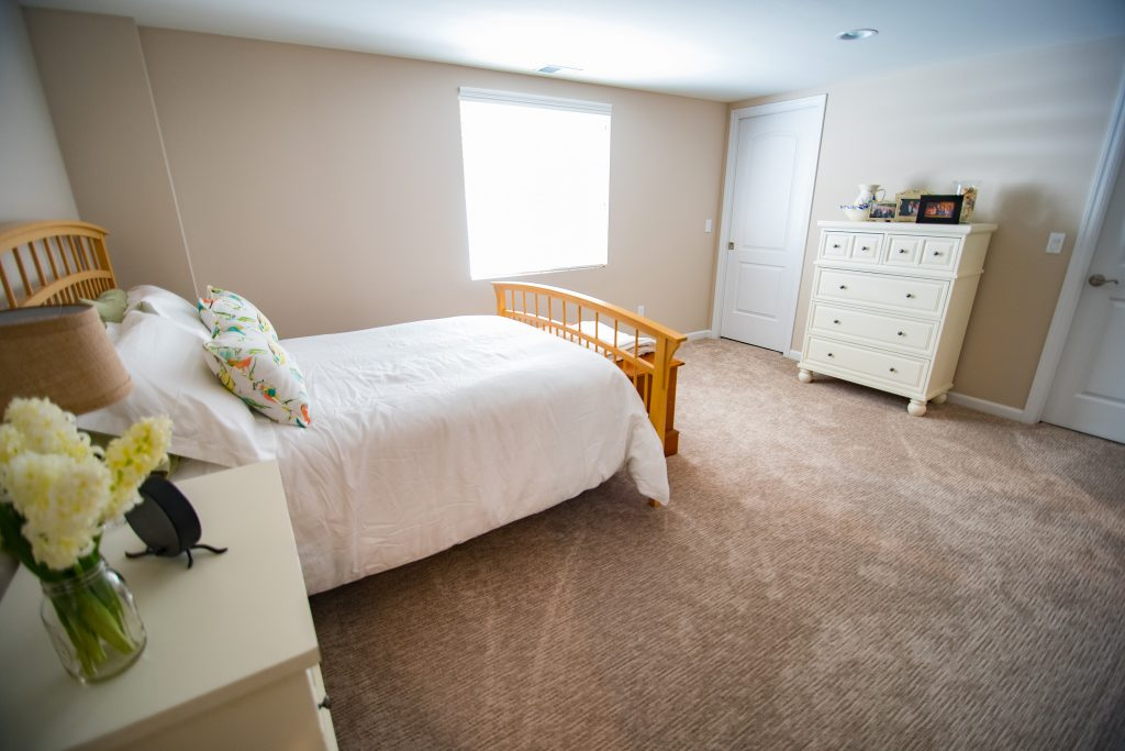 large basement bedroom with egress window and plenty of natural light