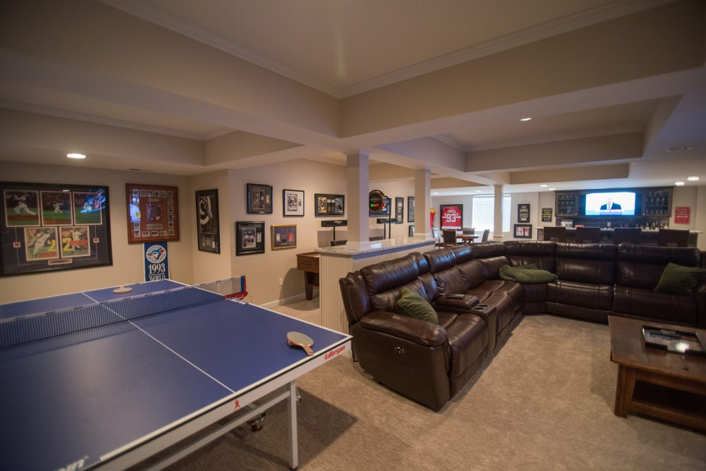 Ceiling detail defining the spaces in this finished basement in Clarkston, Michigan