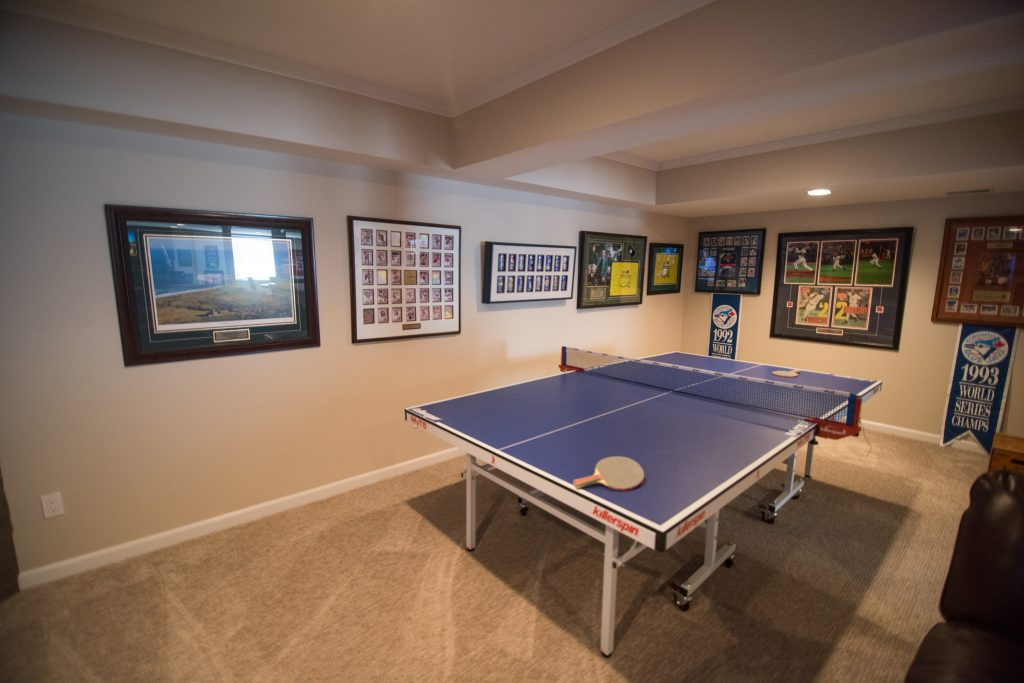 ping pong area with awards and sports memorabilia