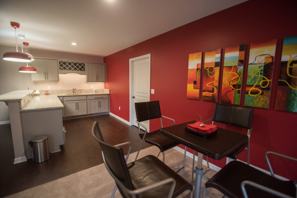 red accent wall in basement bar area