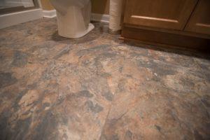 canyon sun colored vinyl tile basement flooring
