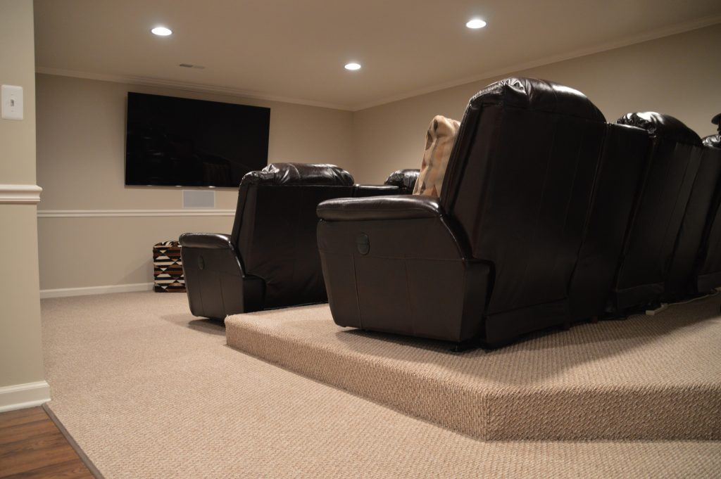basement theater with platform seating for a good view