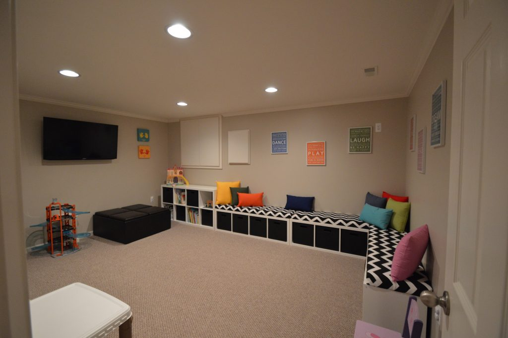 basement playroom for the kids with carpet