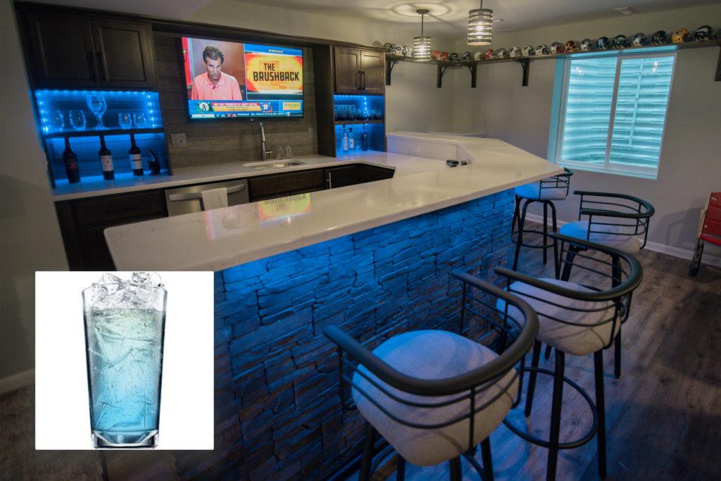 Oakland Township, MI finished basement bar with blue LED lighting inspires Cupids Blue drink