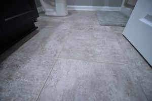 grey colored vinyl tile basement flooring