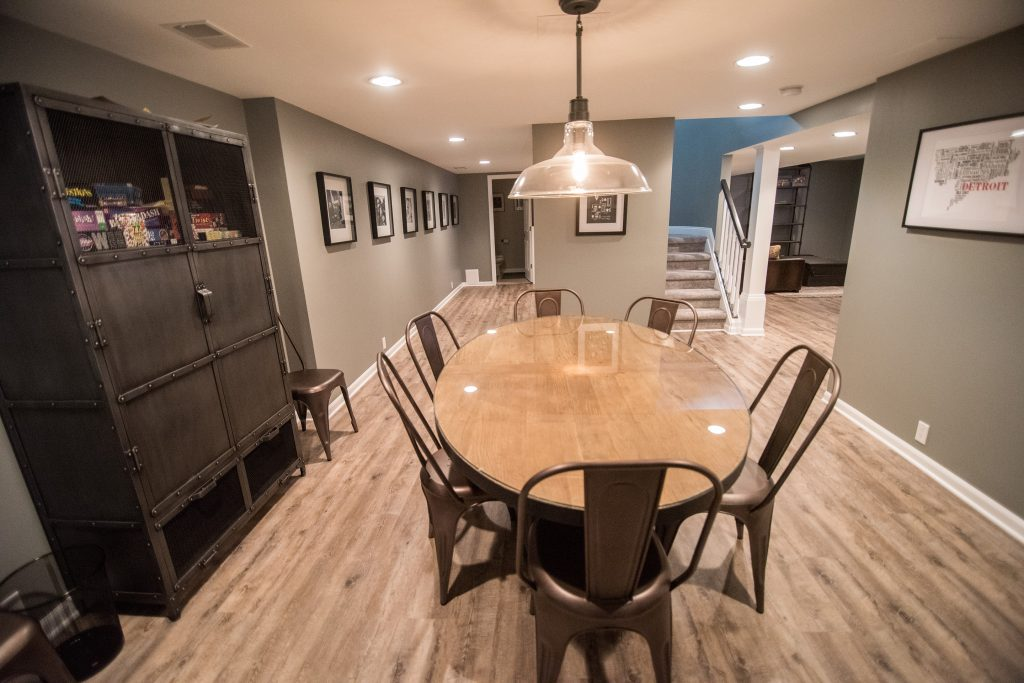 basement dining room with table and ceiling light